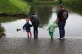 Feeding ducks in any weather Royalty Free Stock Photo