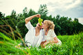 Feeding with grape at the picnic happy young couple making in park Royalty Free Stock Photo