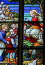 Feeding the multitude stained glass window depicting miracle of jesus with loaves of bread and fish in cathedral of saint Stock Photo