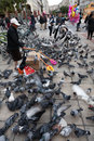 Feeding of pigeons in Aristotelous Square-Thessaloniki-Greece Royalty Free Stock Photo