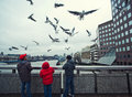 Feeding pigeons in london tourists flying Stock Photography