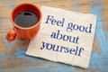Feel good about yourself motivational advice handwriting on a napkin with a cup of espresso coffee Stock Photo