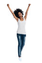 Feeling the excitement excited african woman in casual clothing and afro with arms raised in and joy in studio Stock Image