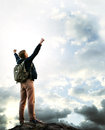 Feeling freedom triumphing young man on the top of mountain Royalty Free Stock Photography