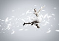 Feeling of lightness young pretty ballerina girl making jump in dance Stock Photos