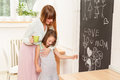 Feeling loved motherand daughter in the kitchen Stock Images