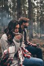 Feeling the warmness. Young beautiful couple enjoying hot drinks Royalty Free Stock Photo