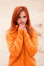 Surprised, cute, nice, happy red-haired, shocked, attractive girl clutch heart. Royalty Free Stock Photo