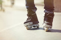 Feet of aggressive inline rollerblader on outdoor skatepark Royalty Free Stock Photo