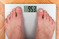 Feet on bathroom scale shot of Stock Photography