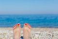 Feet on the beach holiday concept Royalty Free Stock Image