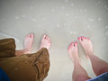 Feet on beach a pair of the touching the water Royalty Free Stock Photos