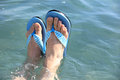 Feet in beach slippers Royalty Free Stock Photo