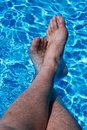 Feet in Blue Water Royalty Free Stock Photo