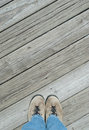 Feet on a boardwalk looking down Royalty Free Stock Photography