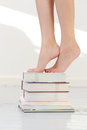 Feet on books beautiful attractive woman Royalty Free Stock Photography