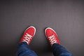 Feet concept with red shoes on black background with space for text or symbol Royalty Free Stock Image