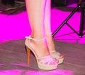 Feet of a girl on stilettos on stage
