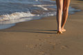 Feet of girl waking on sand Royalty Free Stock Photos