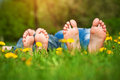 Feet on grass family picnic in spring park children s Royalty Free Stock Photos