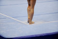 Feet on gymnastics floor Royalty Free Stock Photo