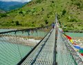 The520 feet high suspension bridge in Punakha swinging over Tsang  river made up with interlocking beam and cantilevel and adorned Royalty Free Stock Photo