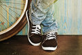 Feet in jeans and sneakers Royalty Free Stock Photo