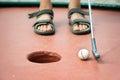 Feet of a kid playing mini golf Royalty Free Stock Photo