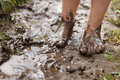 Feet in mud close-up Stock Image