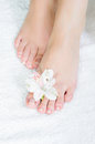 Feet with pedicure and flowers
