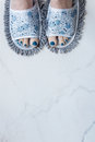 Feet in quirky slippers that are also a mop stuff you buy online Stock Photo