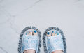 Feet in quirky slippers that are also a mop Royalty Free Stock Photo