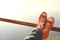 Feet red sneaker a girl in nature and relax time Royalty Free Stock Photo