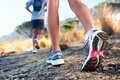 Feet running outdoor trail marathon fitness on rock fitness and healthy lifestyle Stock Photography