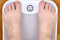 Feet on the scale Royalty Free Stock Photo