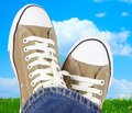 Feet in sneakers Royalty Free Stock Photos