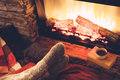 Feet in socks by the fire Royalty Free Stock Photo