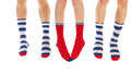 Feet in socks striped and dotted isolated over white background Royalty Free Stock Photos