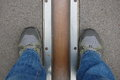 Feet stand on opposite sides of the prime meridian greenwich london uk Royalty Free Stock Image