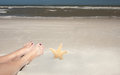 Feet And Starfish Stock Images