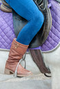 Feet in stirrups young girl on a horse with Royalty Free Stock Photo