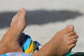 Feet of sunbather on beach Royalty Free Stock Photo