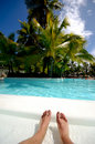 Feet in swimming pool Stock Photography