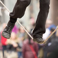 The feet of a tightrope walker photographed while getting in balance Stock Photos