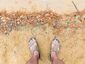 Feet of the traveller standing on the sand Royalty Free Stock Photo