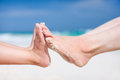 Feet on tropical sand close up of mother and daughter a sandy beach Stock Images