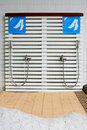 Feet washing outdoor showers in the hotel Stock Images