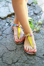 Feet wearing summer sandals Royalty Free Stock Photo