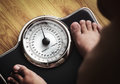 Feet with weight scale Royalty Free Stock Photo