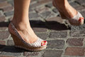 Feet of a woman on cobblestones Royalty Free Stock Photo